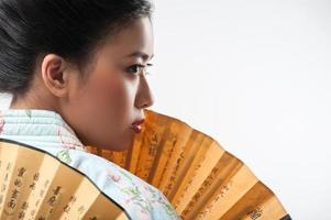 Japanese woman with traditional fan photo