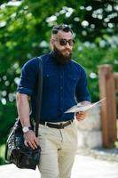bearded man with a map in hand