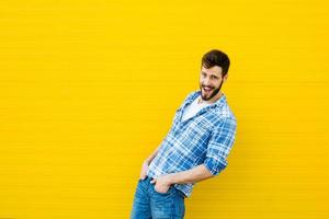 young happy man on yellow