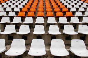 Front of the white and orange seats on stadium