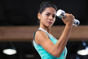 Charming woman workout with dumbbells photo