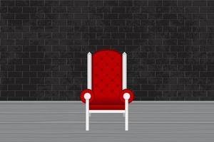 estudio fotográfico con silla roja y pared de ladrillo gris