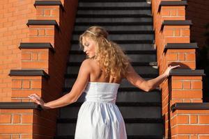 Coquettish young beautiful woman photo