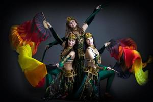 Trio of charming oriental dance performers photo