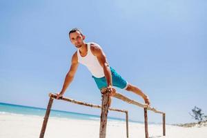 fitness man on the beach photo