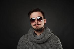 handsome guy with beard in wool pullover photo