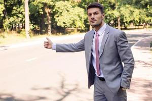 Businessman stopping car