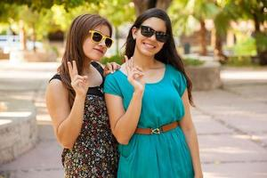 Latin teens with peace signs photo