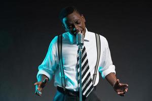 Retro african american jazz singer with microphone.
