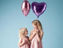 Little Cute Girls Playing with Balloons photo