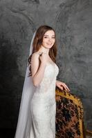 Photo of a beautiful happy bride in luxurious wedding dress