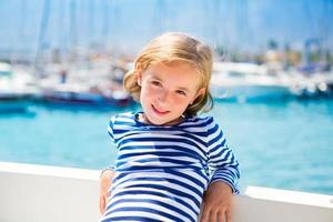 child kid girl in marina boat on summer vacations photo