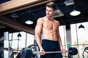Handsome man workout with barbell