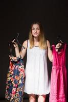 Beautiful young woman show is clothe