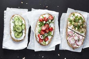 Vegetarian sandwich on black background
