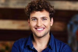 handsome man with curly hair photo