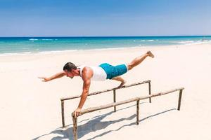 handsome fitness man on the beach photo