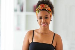 Beautiful African American woman wearing an african head scarf - photo