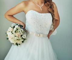 Gorgeous caucasian bride in beautiful dress photo