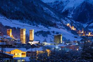 Stone svaneti towers with lights in the mountain village Mestia