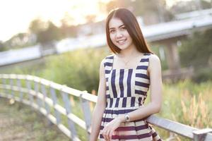 Fashion  of a  autumn girl  wearing  striped Thailand. photo