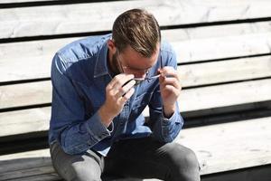 Man sitting down outside