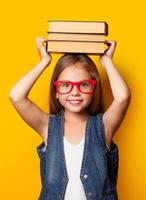 girl in red glasses with books photo
