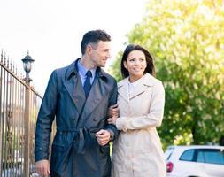 Woman and man walking outdoors photo