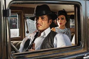 Sneering 1920s Gangster Driver