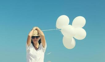 woman with white balloons