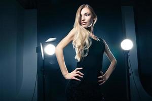 Beautiful woman posing at studio in light flashes
