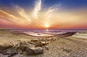 Magical sunset over Baltic Sea coast, Miedzyzdroje in Poland.