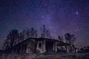 Abandoned building with star sky photo