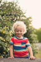 Portrait of boy in summer time photo