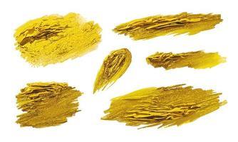 conjunto de trazos de pincel de pintura dorada vector