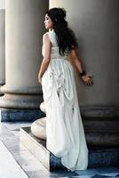 The fine young girl with a light dress. Romance style photo