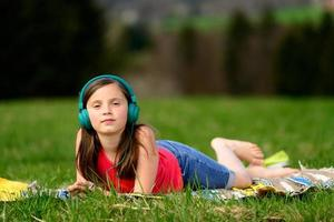 pretty young girl listening to music in nature