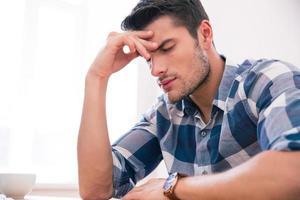 Casual businessman with headache photo
