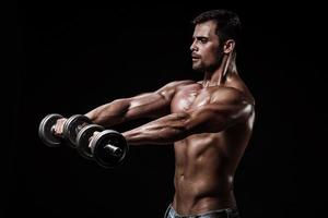 athletic young man on black background photo