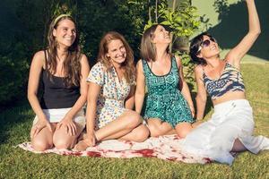 Four best girl friends in the garden photo