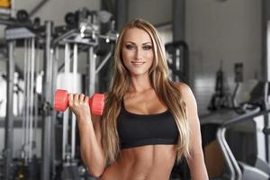 Bodybuilder woman with colorful dumbbells