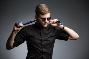 Stylish man in black shirt and mirrored sunglasses photo