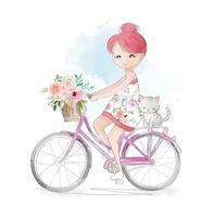 Chica montando bicicleta con gatito