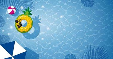 Pineapple inflatable in swimming pool and copy space