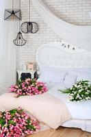 Romantic morning in a chic bedroom with tulips