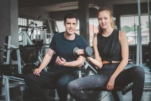 Couple working out together in gym