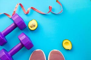 Fitness equipment on color background