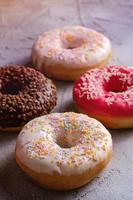 Multi-flavored donuts with sprinkles