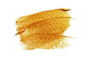 abstrato dourado com pincel de tinta acrílica foto