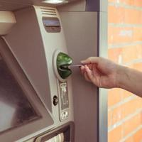 Customer uses ATM to withdraw cash